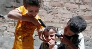 Krieg spielende Kinder im Kriegsgebiet Foto YouTube