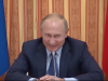 Putin lacht Foto: YouTube Screen