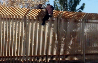 090317-N-5253T-016 DOUGLAS, Ariz. (March 17, 2009) Two men scale the border fence into Mexico a few hundred yards away from where Seabees from Naval Mobile Construction Battalions (NMCB) 133 and NMCB-14 are building a 1,500 foot-long concrete-ined drainage ditch and a 10 foot-high wall to increase security along the U.S. and Mexico border in Douglas, Ariz. (U.S. Navy photo by Steelworker 1st Class Matthew Tyson/Released)