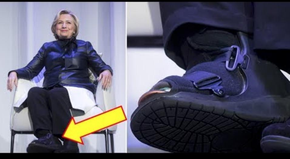 Hillary Clinton mit orthopädischem Schuh, der wahrscheinlich eine Fußfessel verbirgt